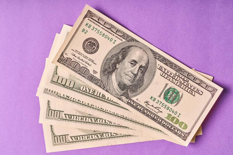 A few American dollars on a paper blue background stock image