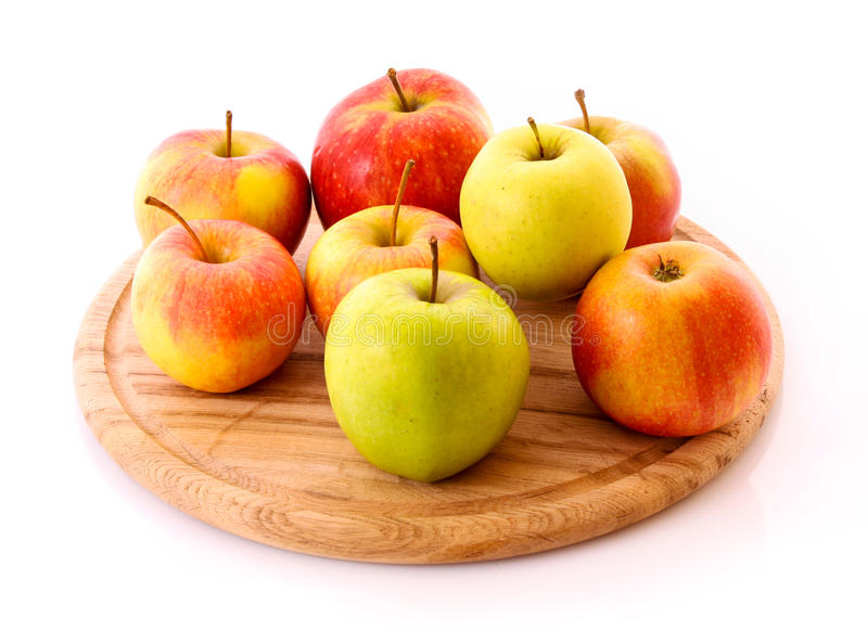 Few apples on wooden tray isolated stock image