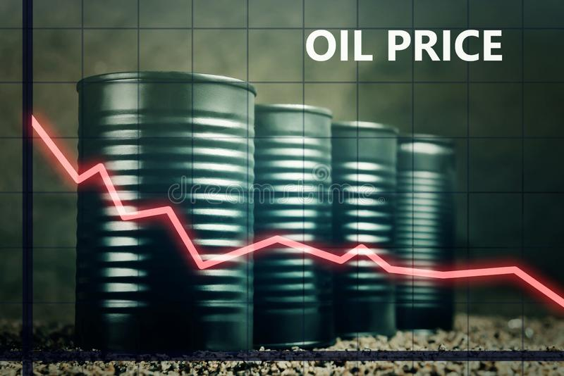 Few barrels of oil and a red graph down - decline in oil prices concept royalty free stock photography