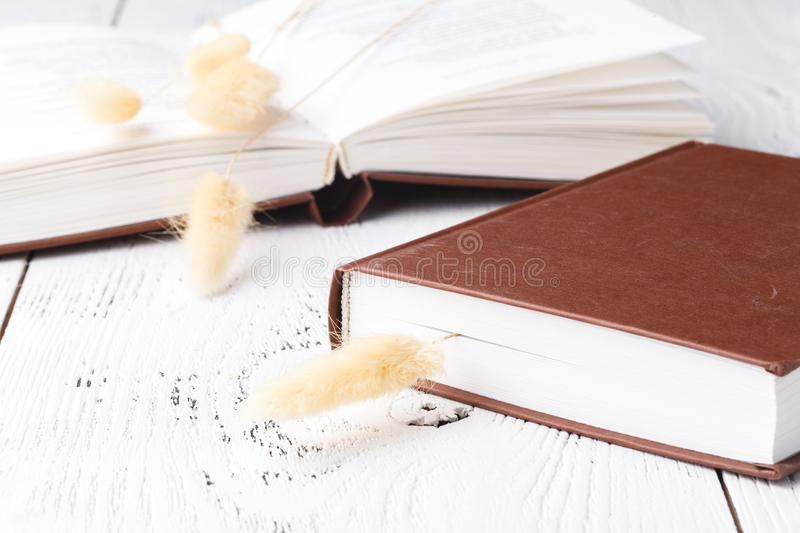 Few books and romantic dry herb on table royalty free stock photo