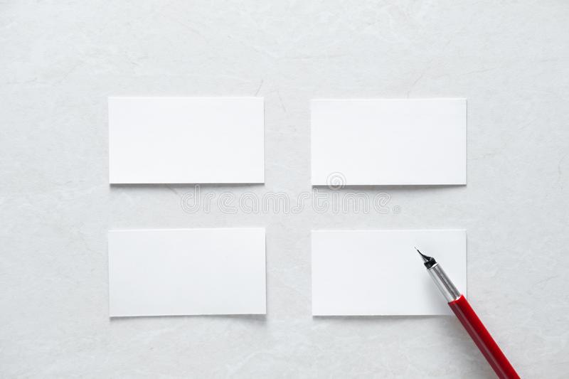 Few clean white business cards with space for text royalty free stock image