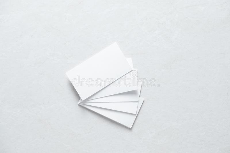 Few clean white business cards with space for text royalty free stock photo