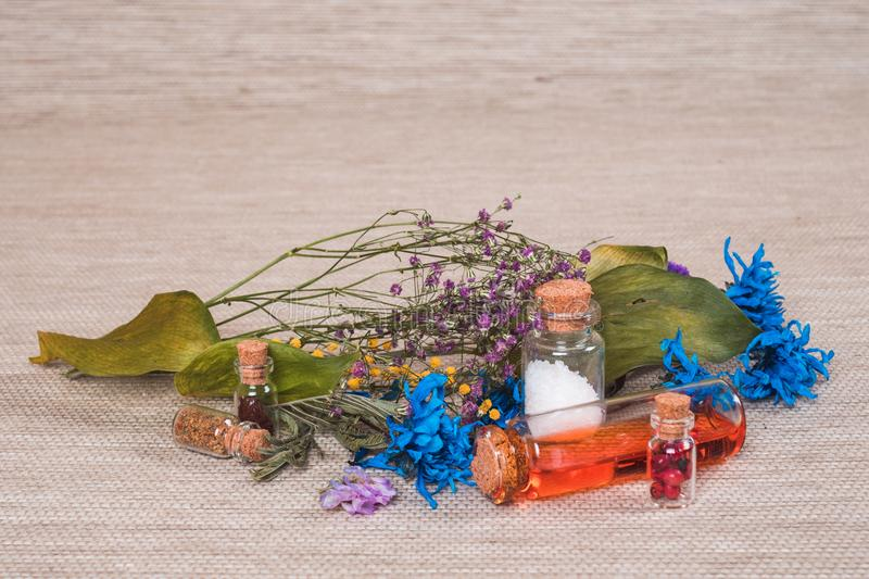 Few colored vials with flovers. Selective focus. royalty free stock photography