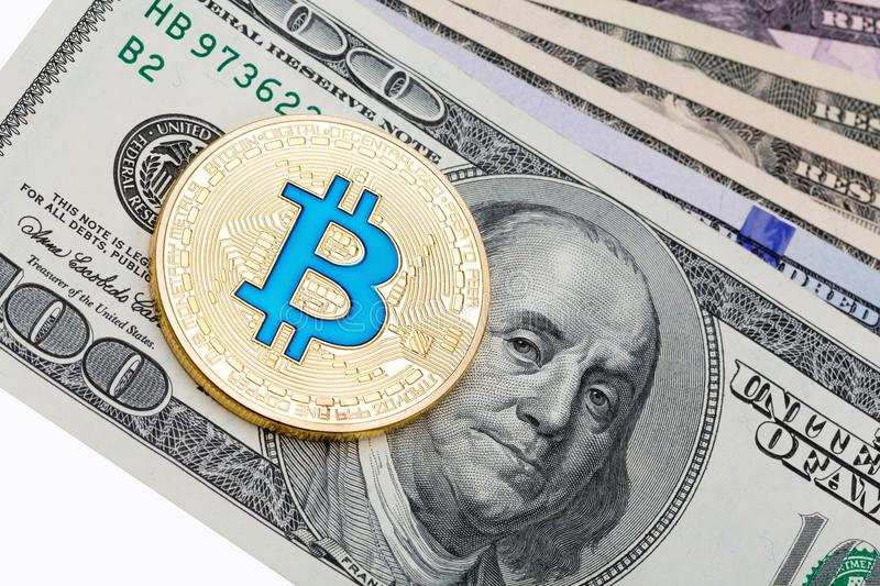 A few dollar banknotes with golden cruptocurrency blue bitcoin o stock photography