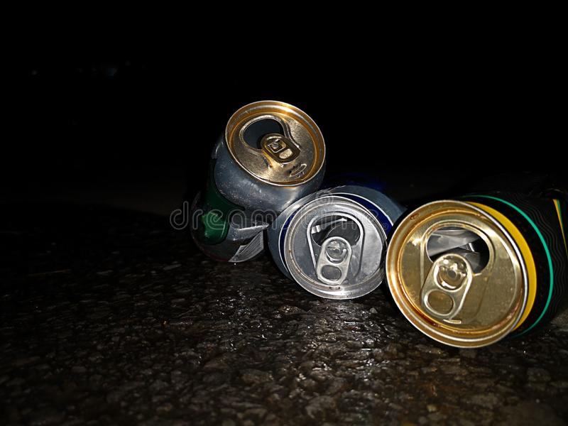 A few empty finished cans of beer design for safety precaution on road. royalty free stock photography
