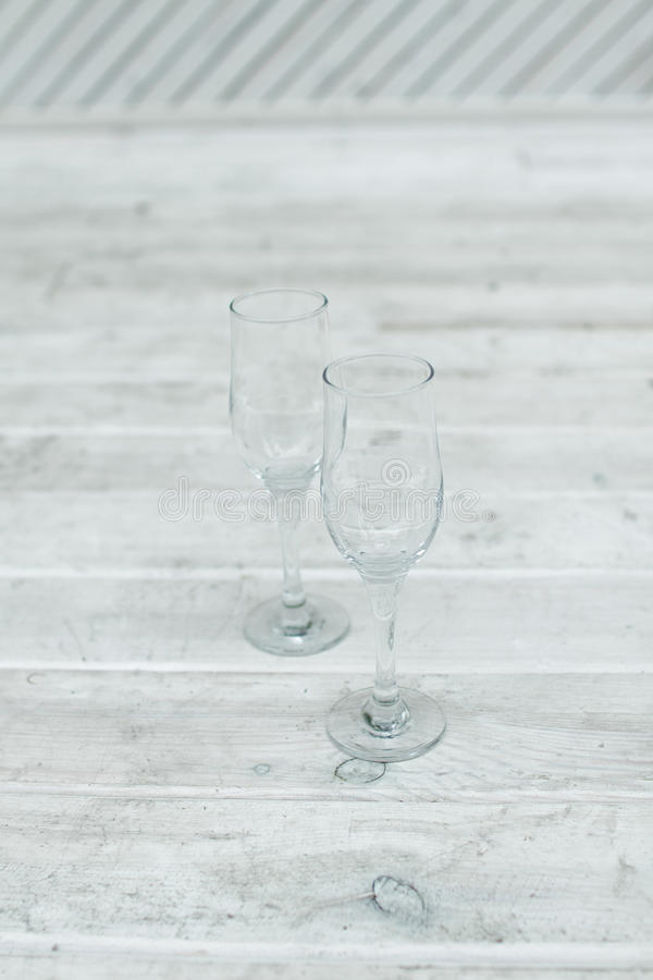 Empty glasses stand on a white wooden background royalty free stock photo