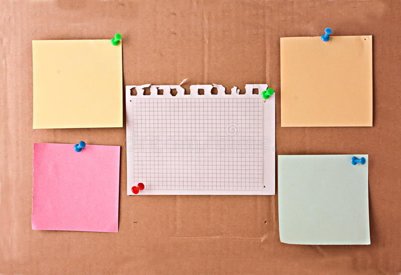 Few memos on card-board background stock photography