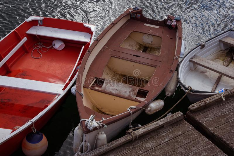 Few old wooden boats at the pier. New England stock photo