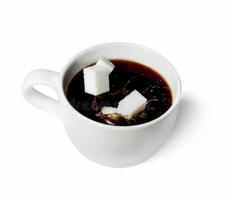A few pieces of sugar falling into a white cup of coffee. White isolated background. Splash. Close up stock image