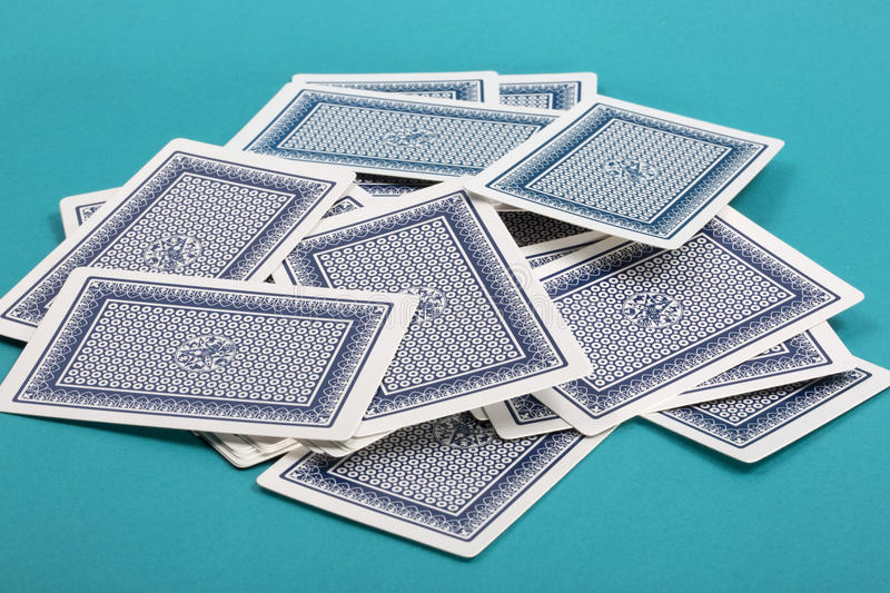 Download A Few Scattered Playing Cards On A Green Stock Image - Image: 83702817