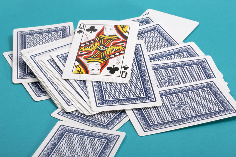 Download A Few Scattered Playing Cards On A Green Stock Photo - Image: 83703907