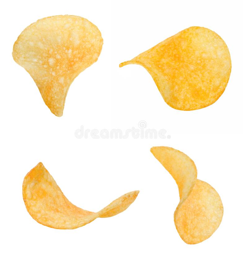 A few slices of crispy chips from different sides. White isolated background. Close-up royalty free stock photography