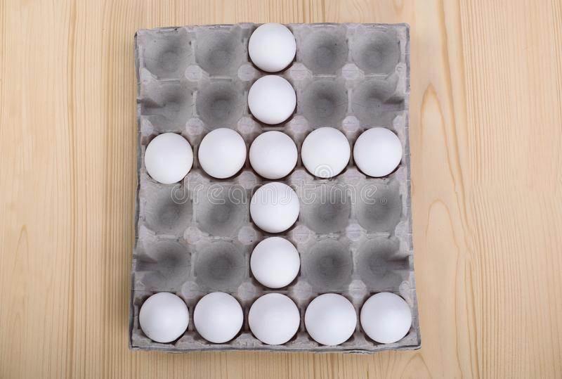 A few white chicken eggs as a cross stock image