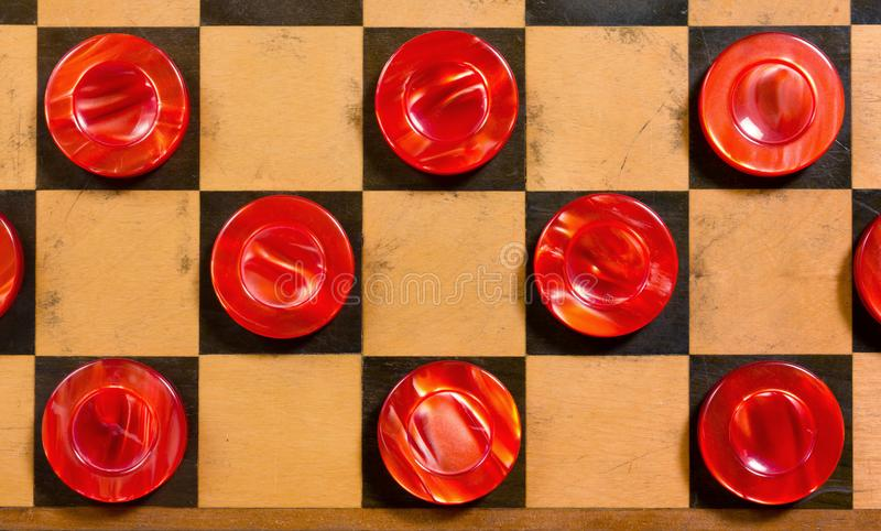 Red Pieces on a Checkerboard royalty free stock images