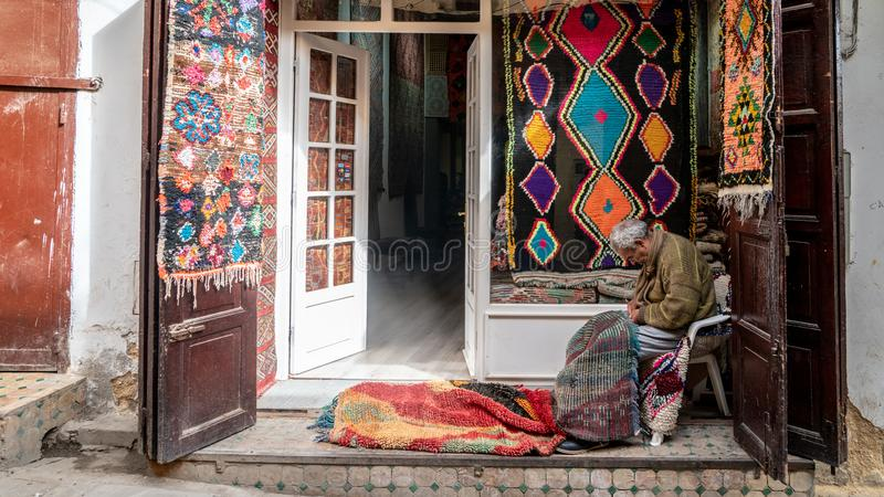 Craftsmen in the Medina o Fez city working traditional handycrafts, Morocco royalty free stock images