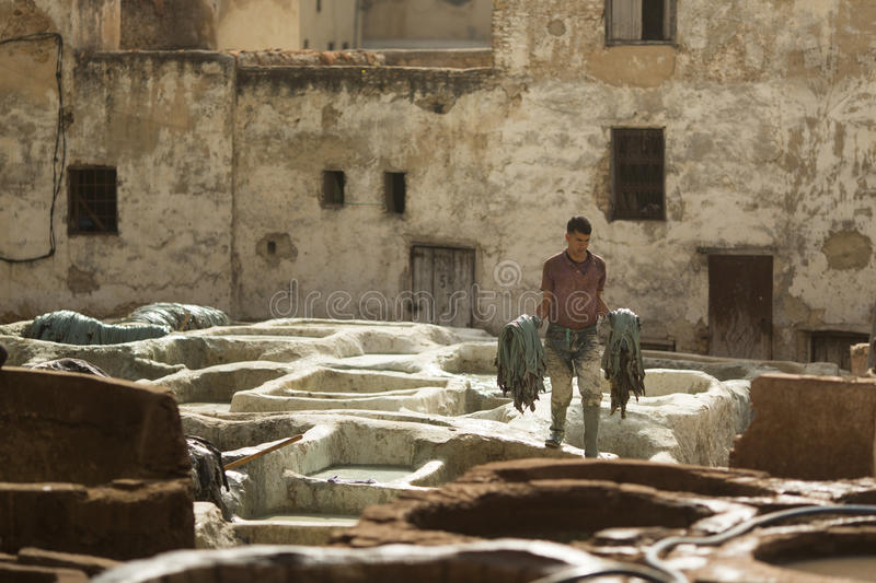 FEZ, MOROCCO - APRIL 19: Workers at leather factory perform the royalty free stock photos