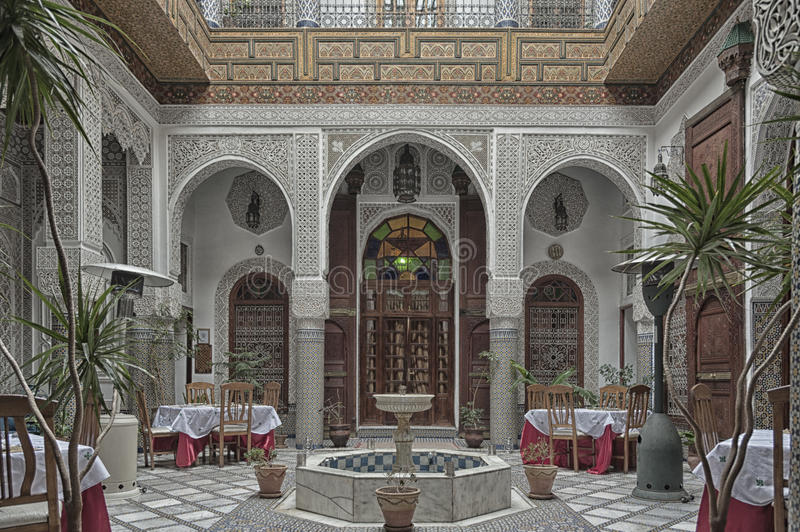 FEZ, MOROCCO - FEBRUARY 19, 2017: Interior of a riad small family owned hotel in the medina of Fes. The medina is listed as a UNESCO World Heritage Site stock images