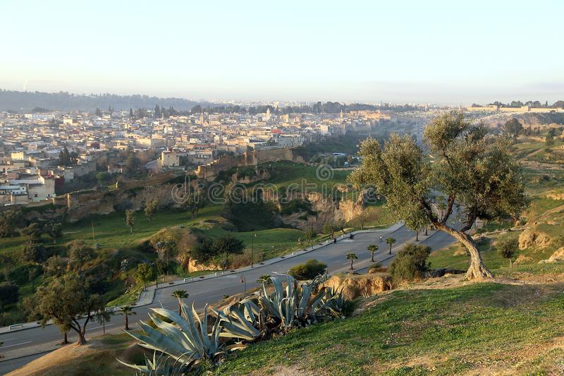 View of the Medina from the hill, where the ruins of the Merenides` tomb are preserved at dawn stock images
