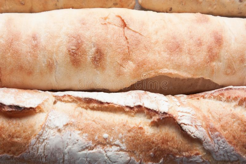 Ffreshly baked long baguettes as food background royalty free stock image