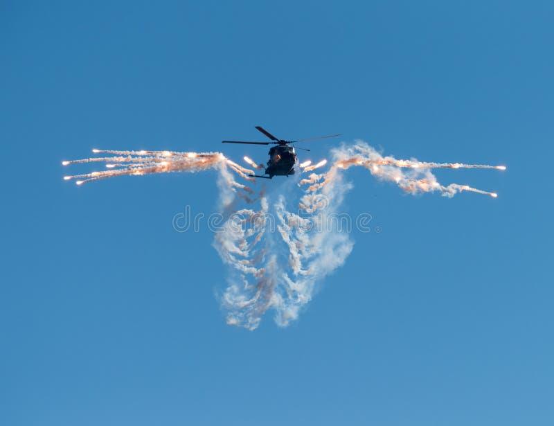 Fińska wojska NH-90 śmigłowcowa strzelanina out migocze zdjęcie royalty free