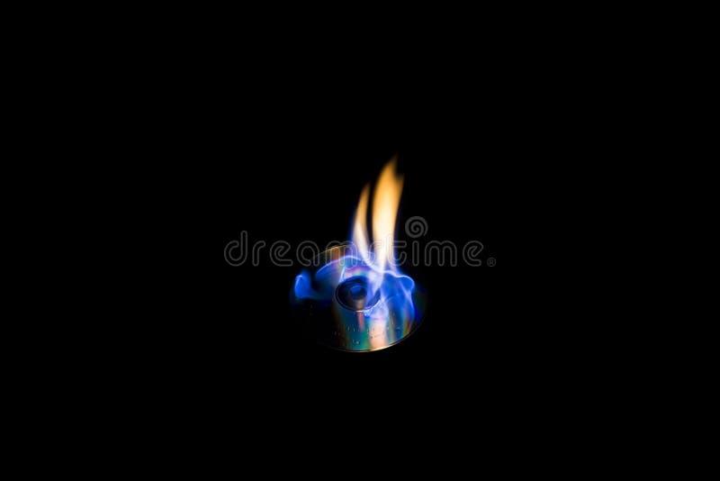 Fiamma blu del CD bruciante fotografia stock