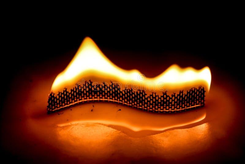 Fiamma del fuoco della candela della curva fotografia stock