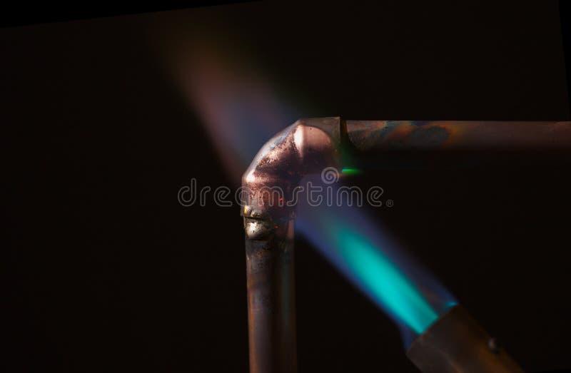 Fiamma della lampada per saldare e tubo del rame immagine for Miglior isolamento del tubo di rame