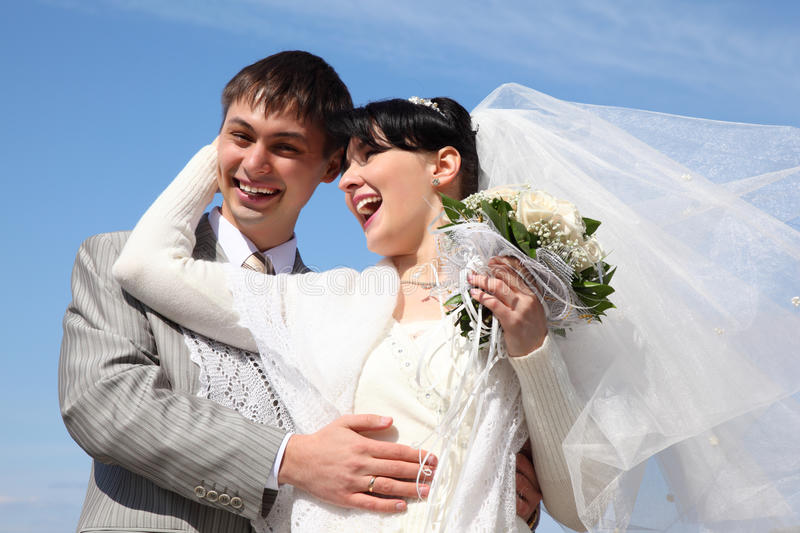 Fiance with bride against background of sky. Smiling fiance with bride against background of sky stock images