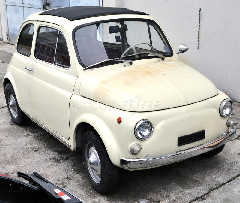 Fiat 500. Vintage Fiat 500 at auto service for restoration. The Fiat 500 is a car produced by the Fiat company of Italy between 1957 and 1975 royalty free stock photography
