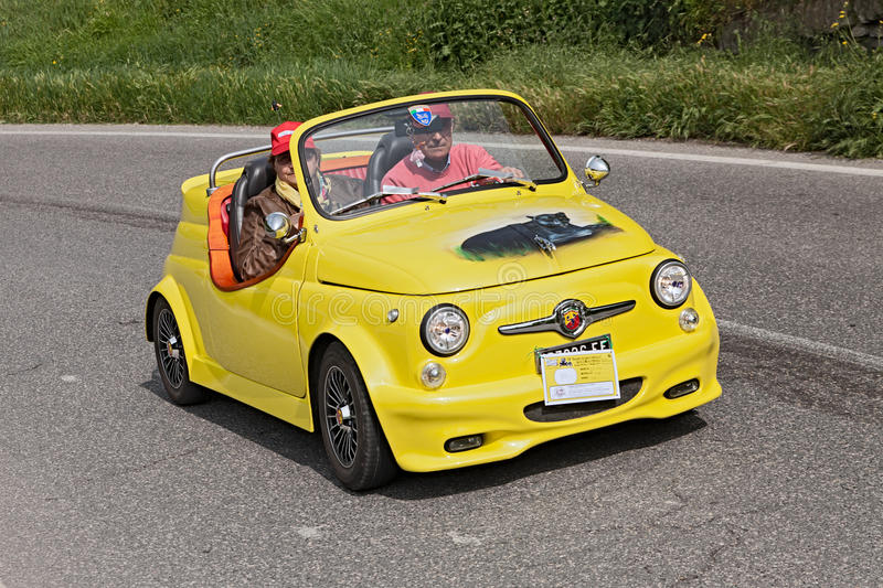 Fiat 500 Abarth roadster. A yellow vintage tuned car Fiat 500 Abarth roadster running in rally for classic cars Raduno colline di cristallo on May 1, 2013 in royalty free stock photography