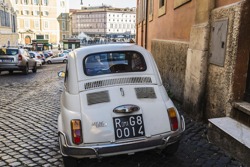 Fiat 500 car parked in Rome, Italy royalty free stock image
