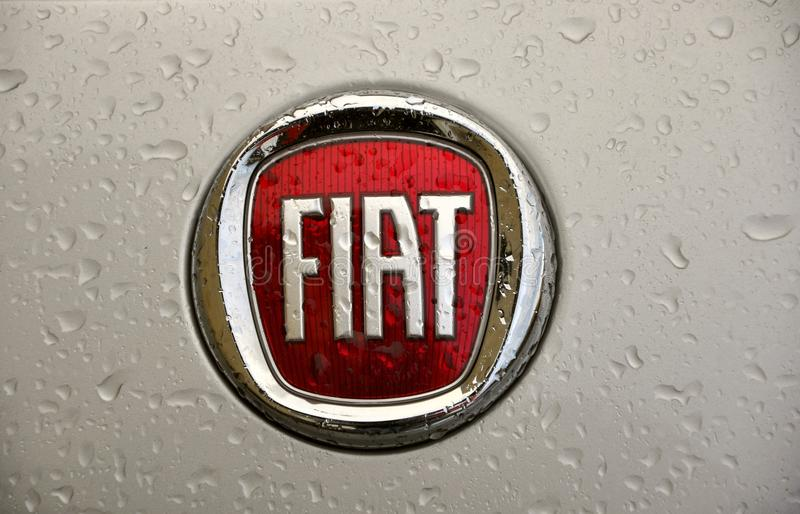 Fiat logo. With rain drops on a silver car. Fiat Automobiles S.p.A. is an Italian automaker which produces Fiat branded cars, and is the largest automobile royalty free stock image