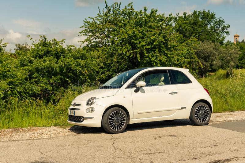 Fiat 500 white parked on a street outside the city in Assisi, Umbria stock photo