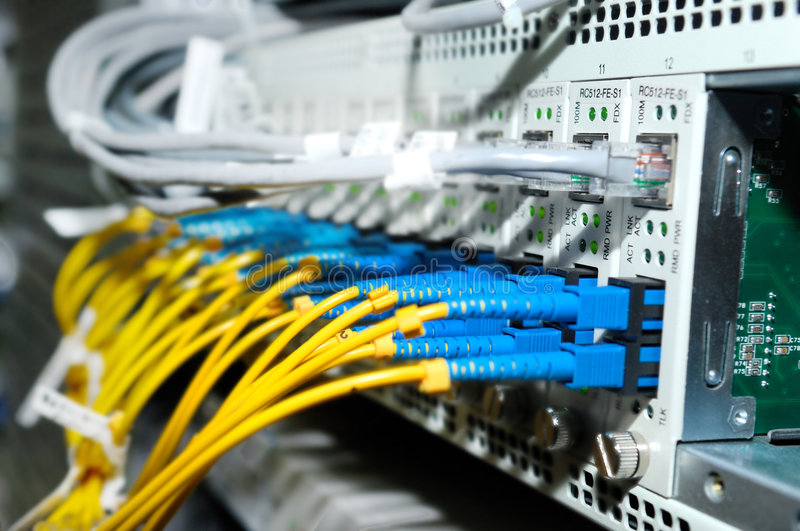 Fiber cables. Connected to servers in a datacenter royalty free stock photos