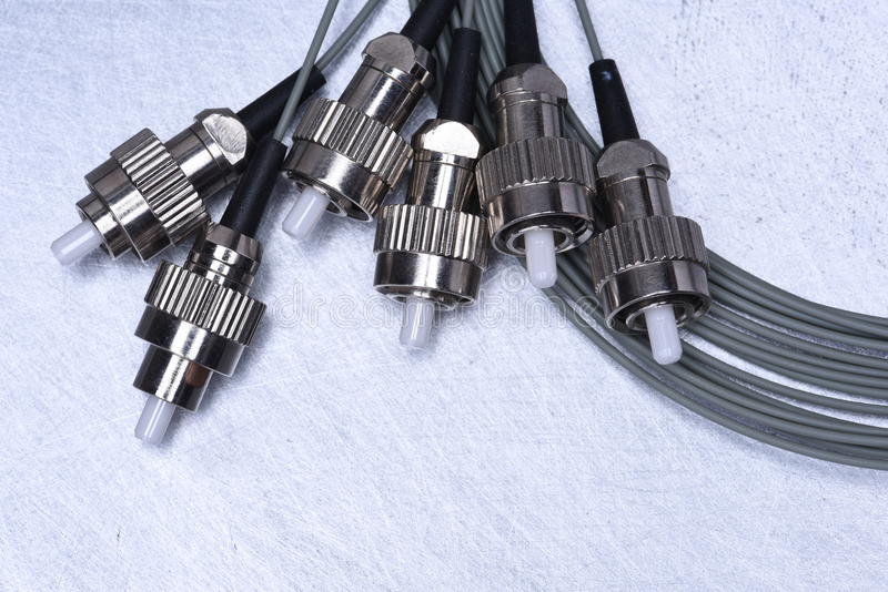Fiber optic cable in telecommunication networks. On metal background royalty free stock photo