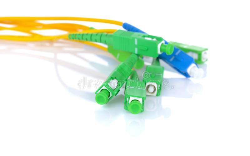 Fiber optic cables on white background stock photos