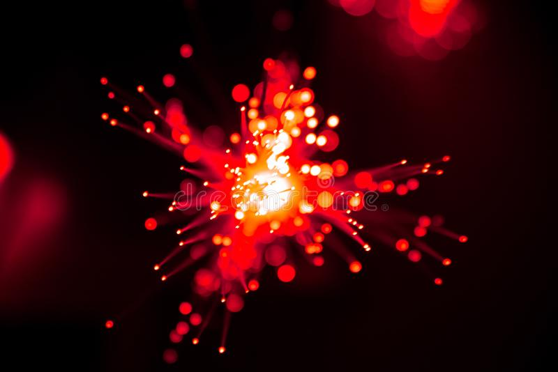 Fiber optic light abstract bokeh background with warm color. Out of focus stock photo
