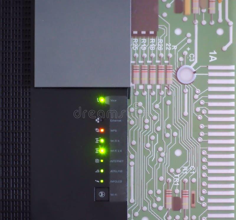 Fiber optic modem on a computer motherboard. Status ok royalty free stock image