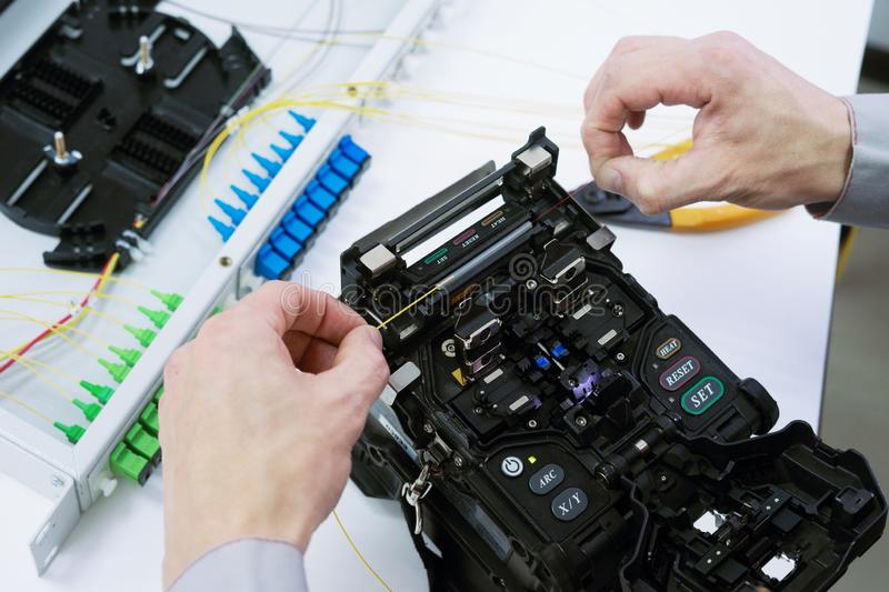 Fiber Optic Splicing by fusion splicing machine stock photography