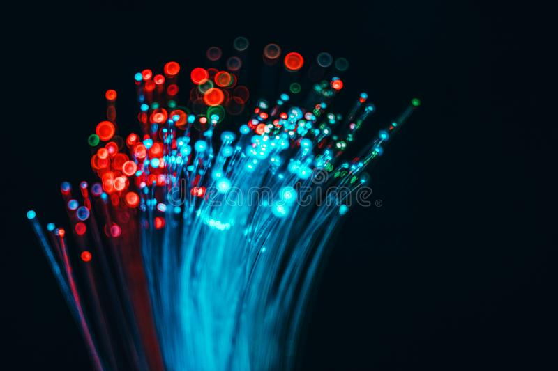 Fiber optical network cable and blurred light for background and royalty free stock photo