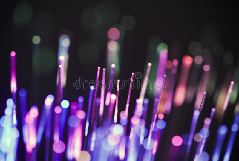 Fiber optics. Purple and violet fiber optics background stock images
