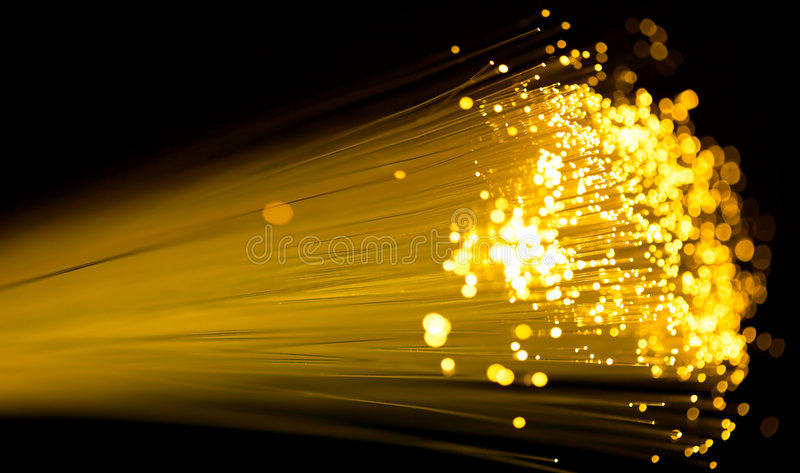 Fiber optics. Yellow fiber optics cable close up shot stock photography