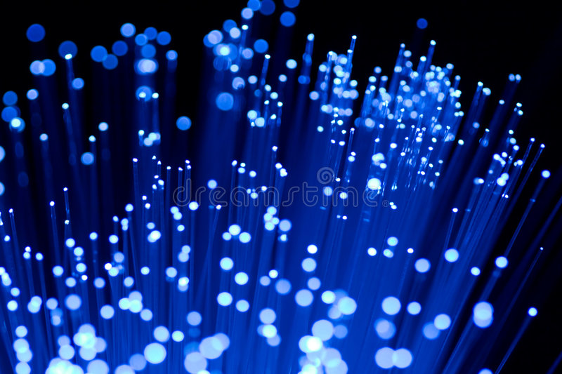 Fiber optics close-up. Focal point on middle fibres stock photography