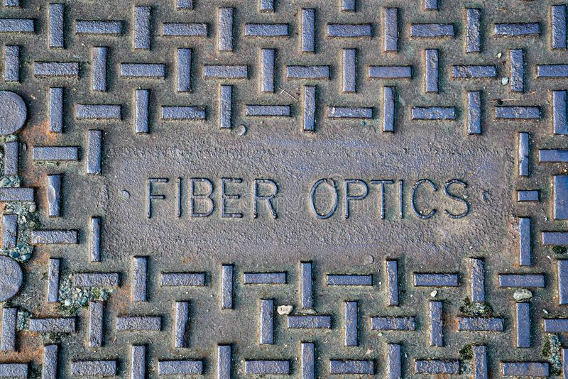 Fiber optics metal access cover royalty free stock image