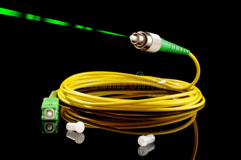 Fiber optics path cord on the black background royalty free stock photos
