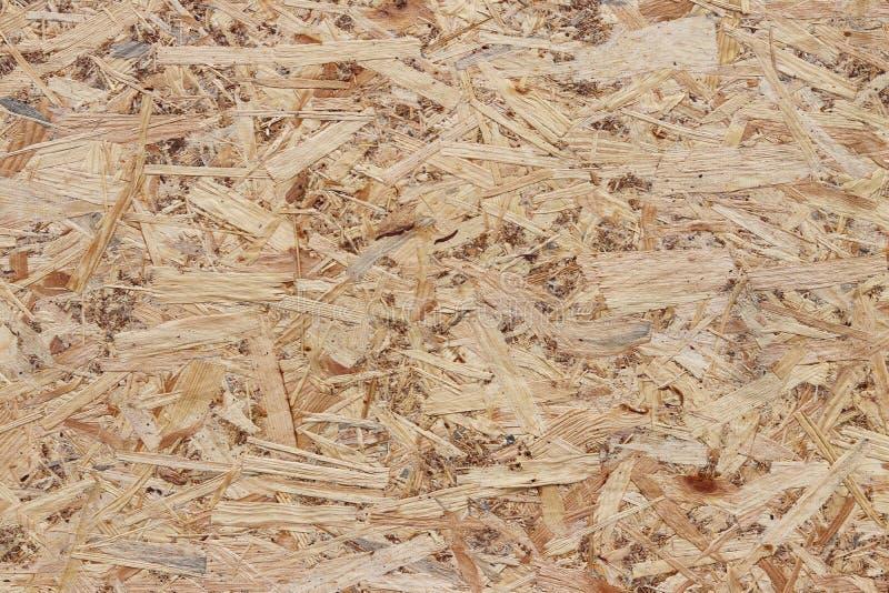 fiberboard Komprimerat ljus - brun träkryssfanertextur Övre yttersida för slut av den pressande trä-raka plattan Gamla träbrädeba arkivbilder