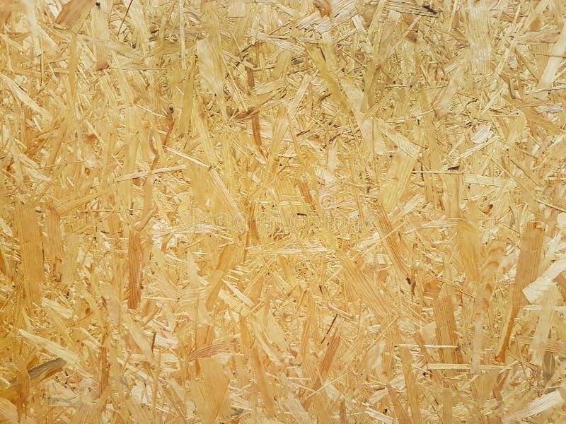 fiberboard Komprimerat ljus - brun träkryssfanertextur Övre yttersida för slut av den pressande trä-raka plattan Gamla träbrädeba royaltyfria bilder