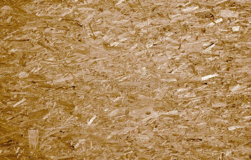 fiberboard Komprimerat ljus - brun trätextur royaltyfria bilder