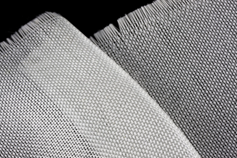 Fiberglass cloth on black backround. Fiberglass cloth with one fold and edge on black background stock images