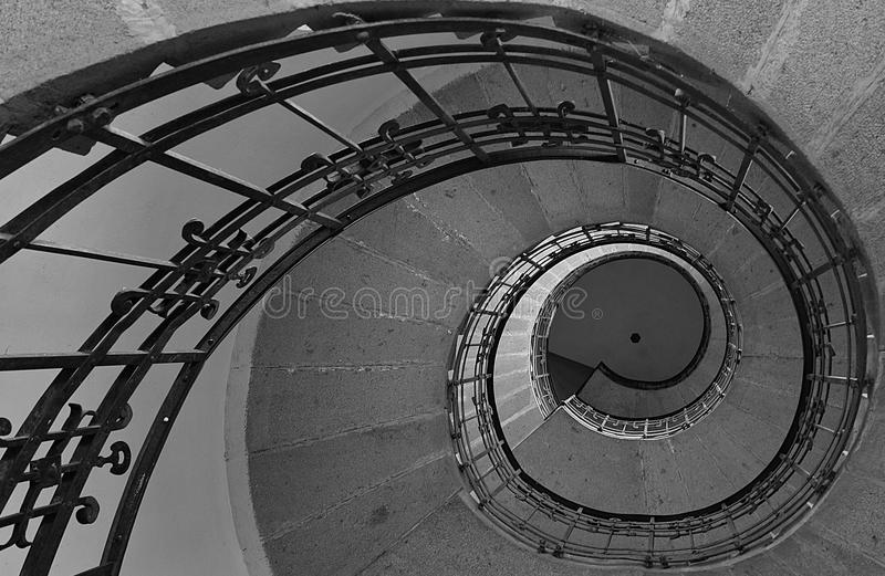 Fibonacci spiral. Spiral stairs in an old historical church which gives the fibonacci spiral look